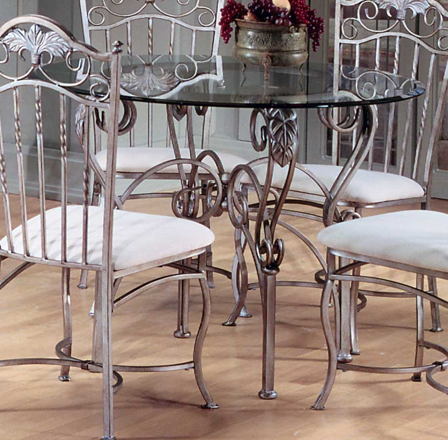 Dining table wrought iron glass dining tables for Glass dining table and chairs