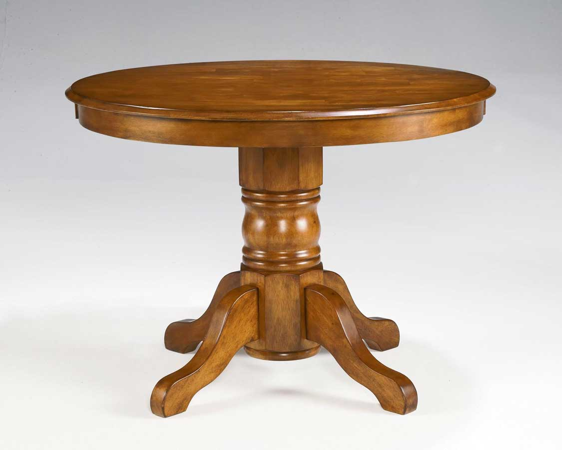 Home styles round pedestal dining table cottage oak 88 for Pedestal table