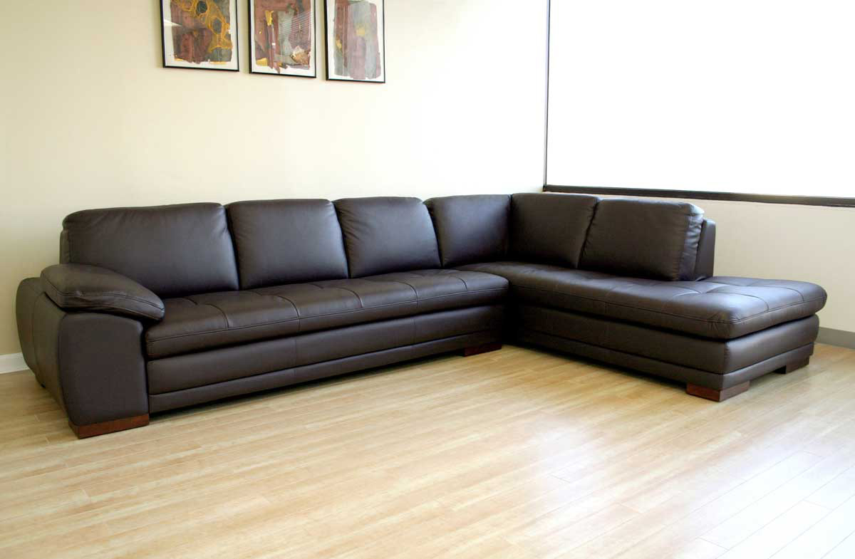 brown microfiber l sectional with dark leather trim and chaise loun